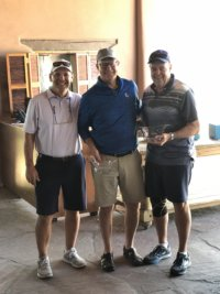 Left to Right, Tom Walsh congratulates Low Net Team Champions Mike Brown and Bob Page